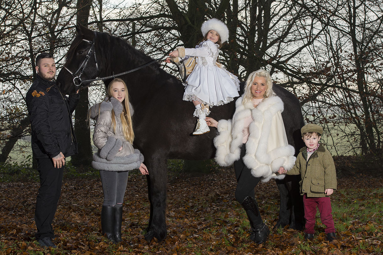 family lifestyle shoot in the woods with their horse
